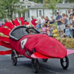 Photo by Jonathan Phillips Sage Powell steers a squid down Madison Ave. in Decatur during the 4th annual Madison Ave. Soap Box Derby on Saturday, September 27, 2014.